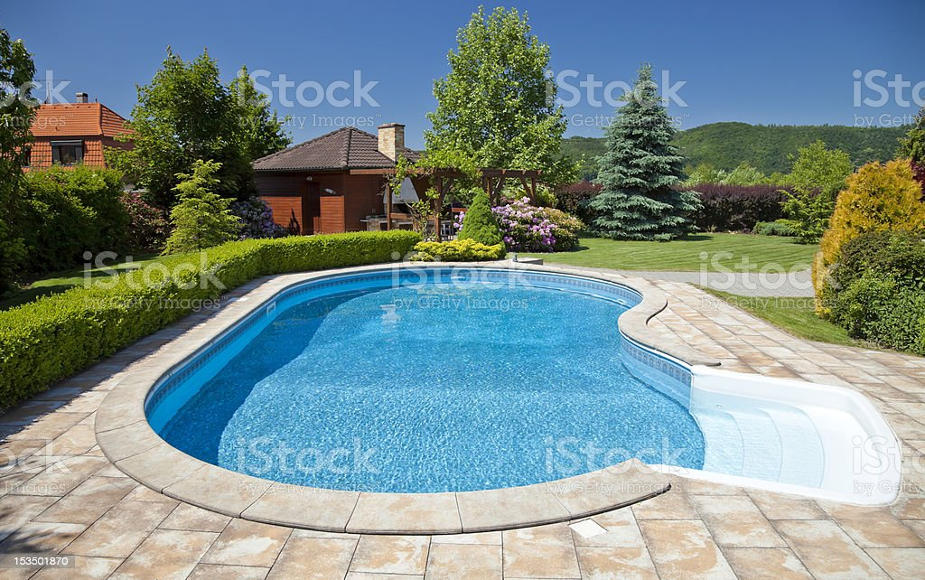 Odd shape pool on a sunny clear day stock photo