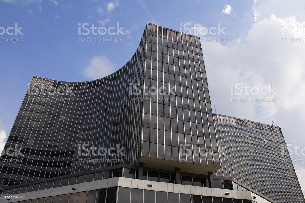 Odd shaped office building in Brussels Office building in Brussels with 3 wings. Combination of curved and straight segments. Adventure Stock Photo