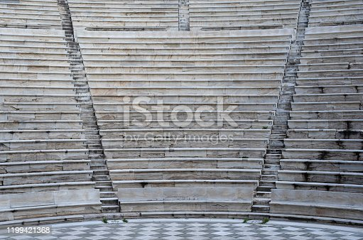 Odeon of Herodes Atticus interior  in Athens, Greece. Also known as Herodeion is a stone Roman theater located on Acropolis hill slope.