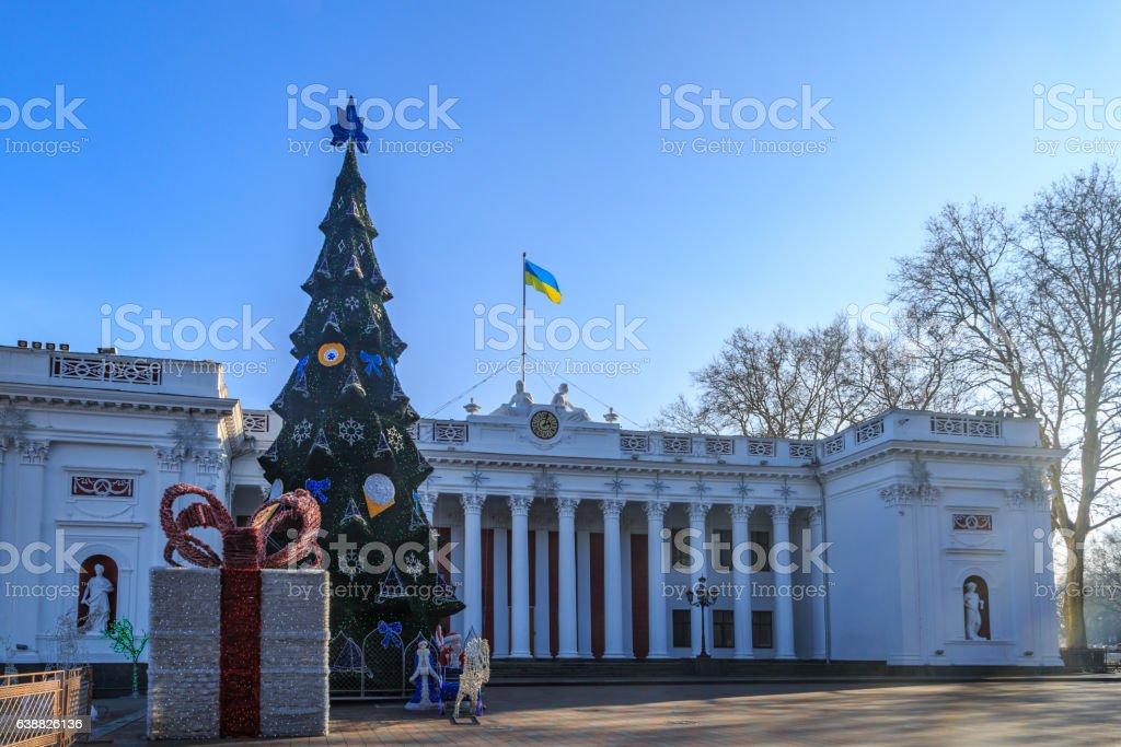 Odessa city hall with christmas tree, decorations and ukrainian stock photo