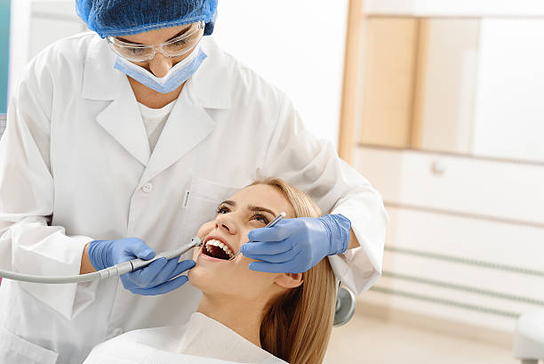 odontologist drilling in mouth of client - 歯科医師 ストックフォトと画像