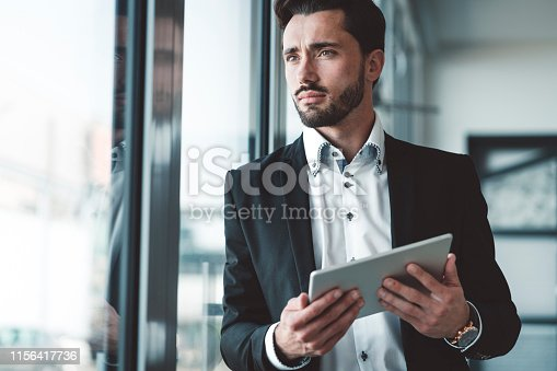 istock CEO of a start-up company - Young bearded businessman 1156417736