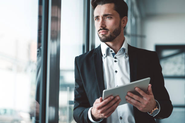 CEO of a start-up company - Young bearded businessman stock photo