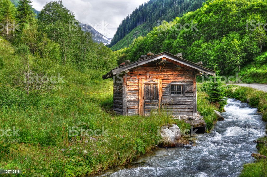 HDR of Barn in alpine river landscape (Austria) royalty-free stock photo