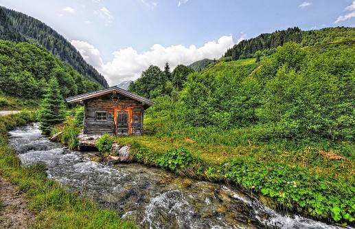 HDR of Barn in alpine river landscape . Schwachzach valley in Tirol.