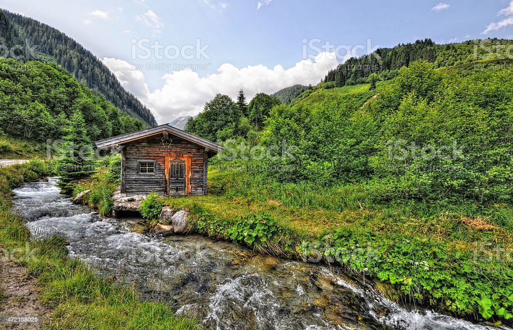 HDR of Barn in alpine river landscape (Austria) stock photo