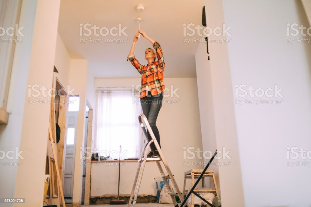 Of course she can change a lightbulb stock photo
