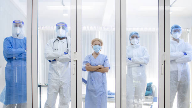 5 of Dortor, Nurse and patient looking out in the quarantine room stock photo