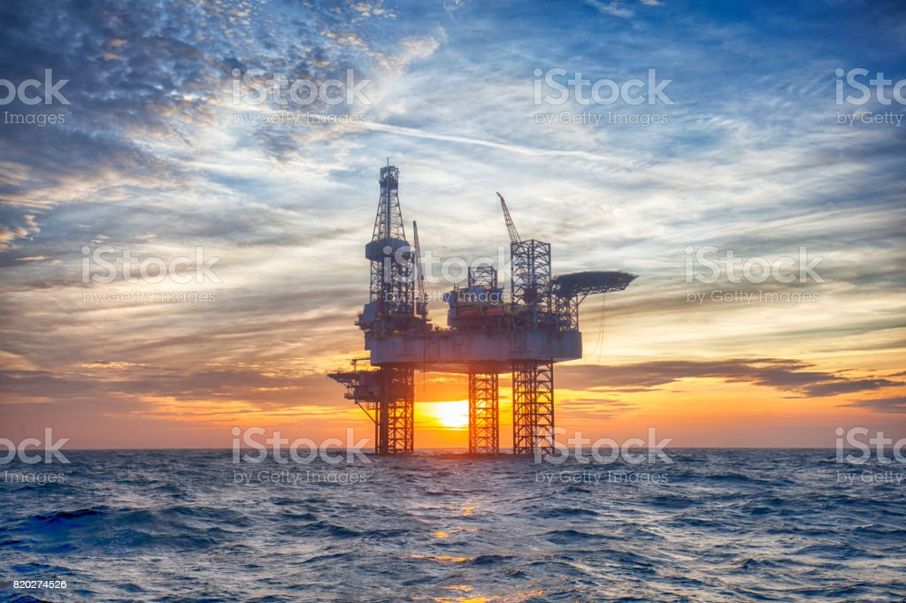HDR of Offshore Jack Up Rig in The Middle of The Sea at Sunset Time stock photo