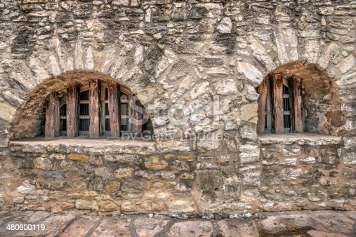 An high dynamic range image of the exterior wall and window of the Alamo.