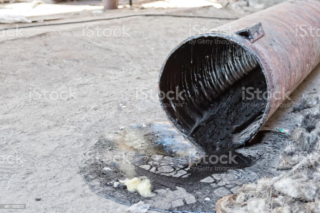 Of the cut piece of pipeline flow remains viscous black petroleum products stock photo