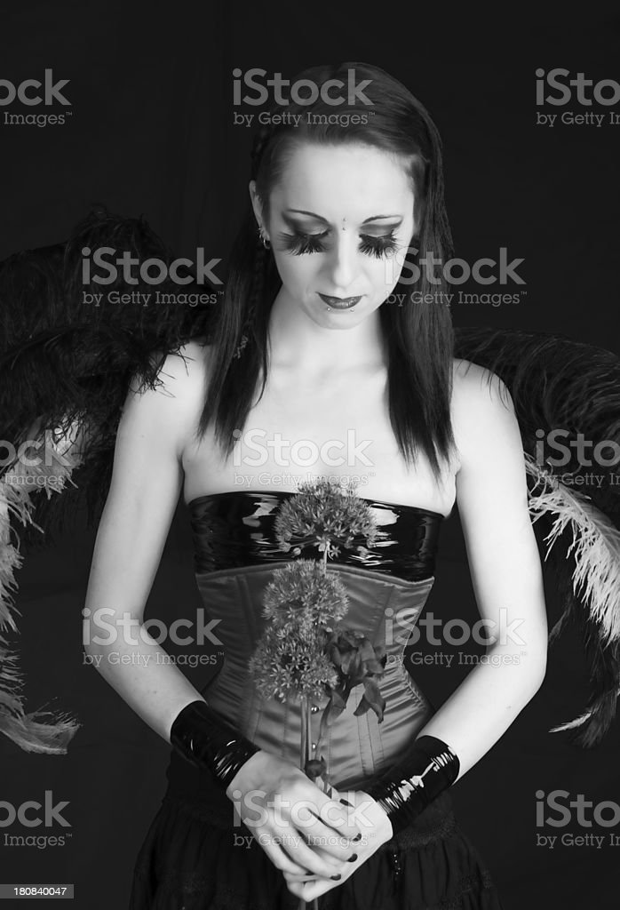 B&W of winged woman with flowers. stock photo