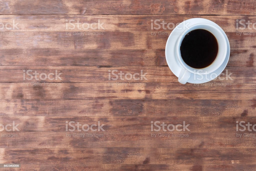 Off center coffee cup and saucer with copy space stock photo