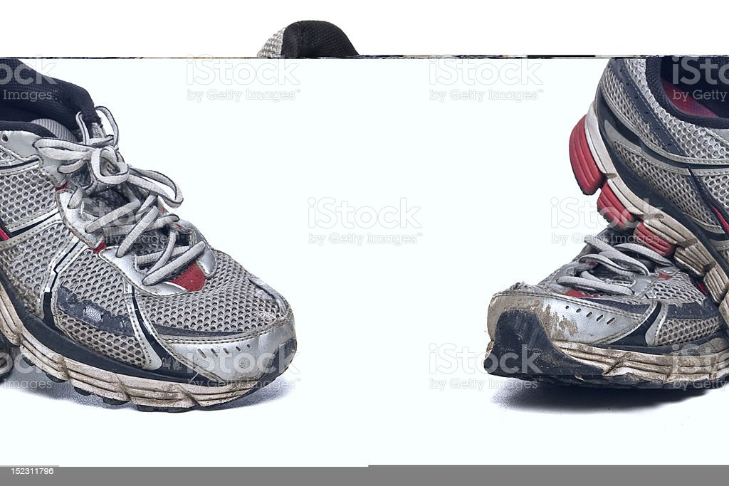 Off center photo of silver and red running shoes royalty-free stock photo