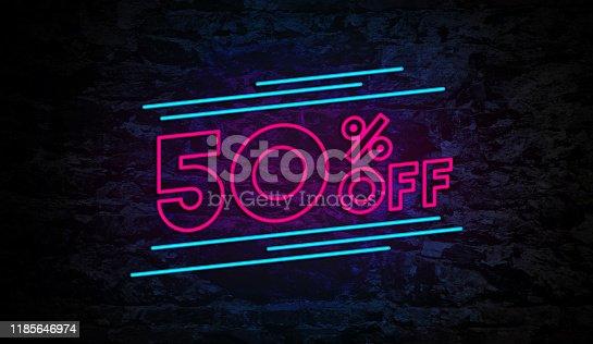 istock 50% Off Neon Sign on Brick Wall 1185646974