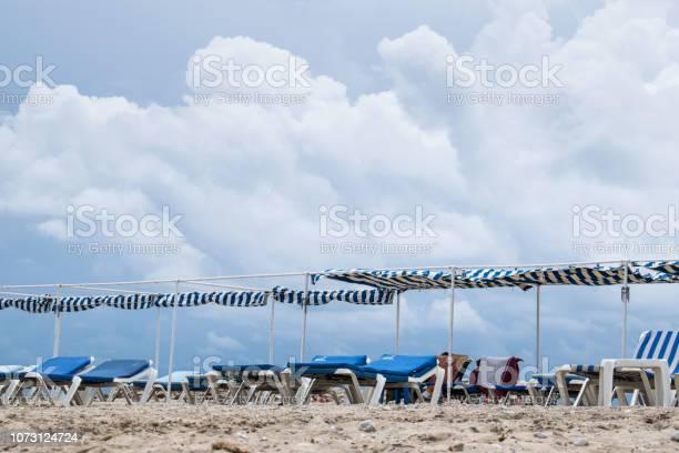 Photo of Off peak season beach with empty lounge chairs