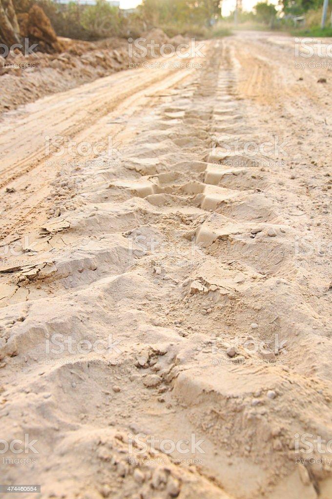 Off road 4X4 wheel tracks on road sand motoring stock photo