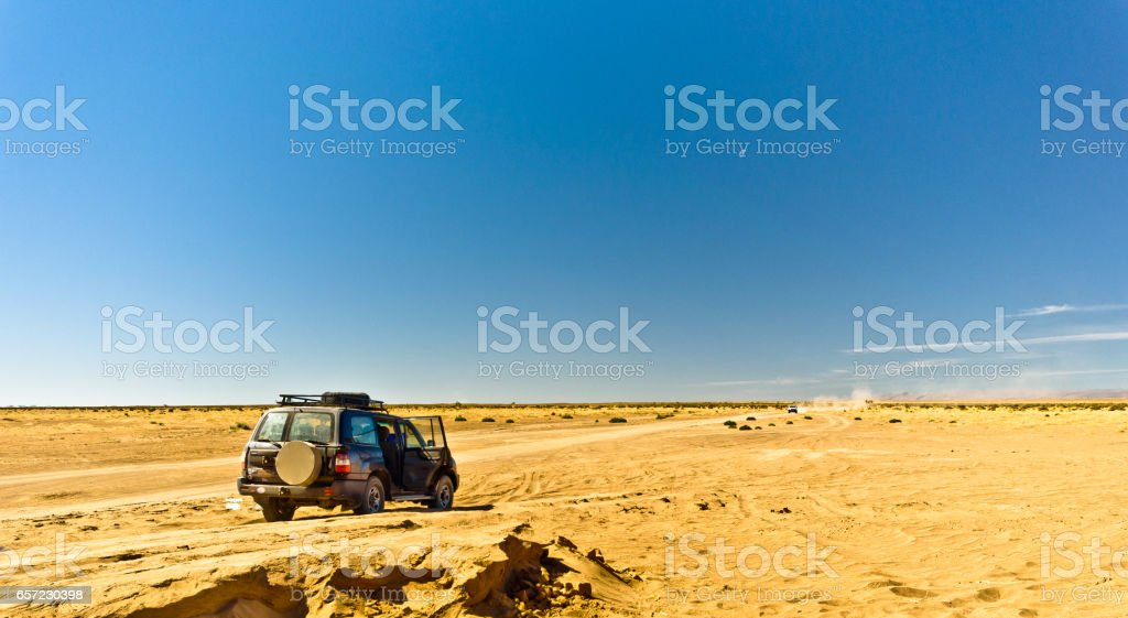 Off road Tour with 4x4 SUV car in Morocco desert stock photo