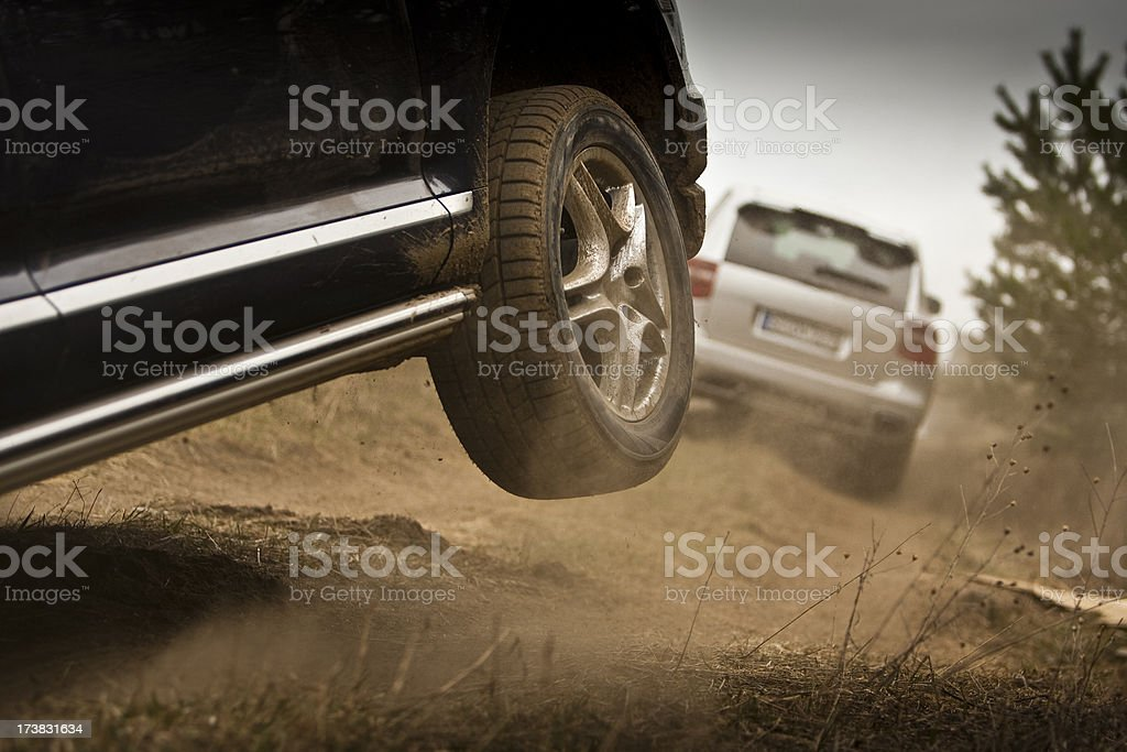 Off road vehicle driving along muddy trail royalty-free stock photo