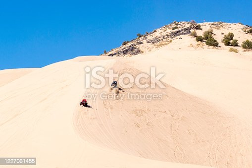 These off road vehicles appear to be heading straight up the sand dunes of Sand Mountain at the Little Sahara Recreation Area in Utah.