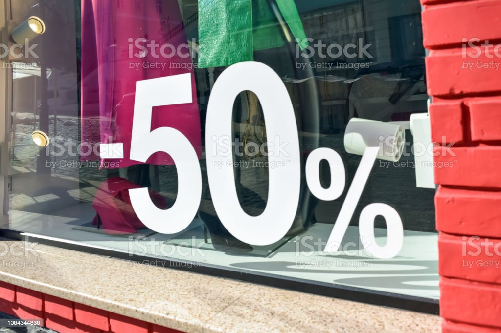 50% off sale discount promotion sale poster, banner, ads in store, shop, drugstore, market window. Sale banner promotion offer percent discount ads in women clothing store boutique. stock photo