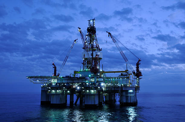Off Shore Drilling Platform at Twilight. Oil rig and reflection