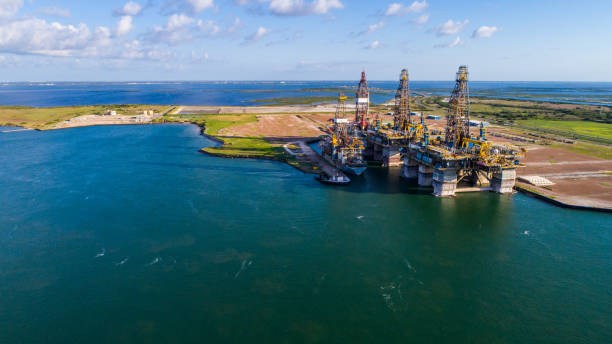 Off Shore Oil Drilling Rig being Deconstructed on Island on the Gulf of Texas stock photo