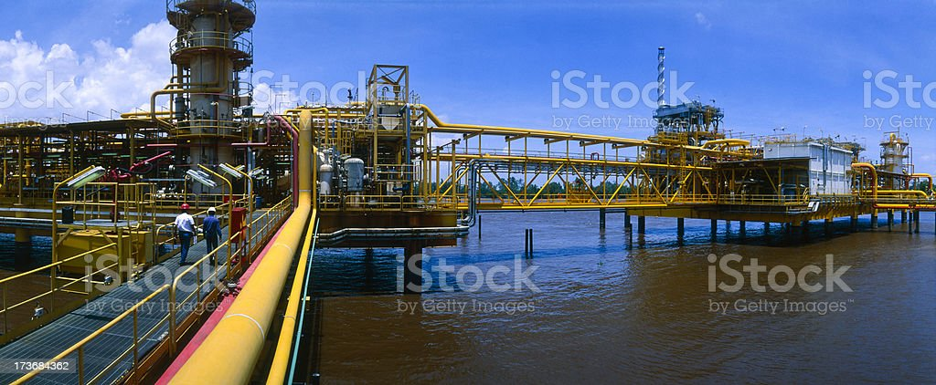 Off shore oil industry with some engineers royalty-free stock photo