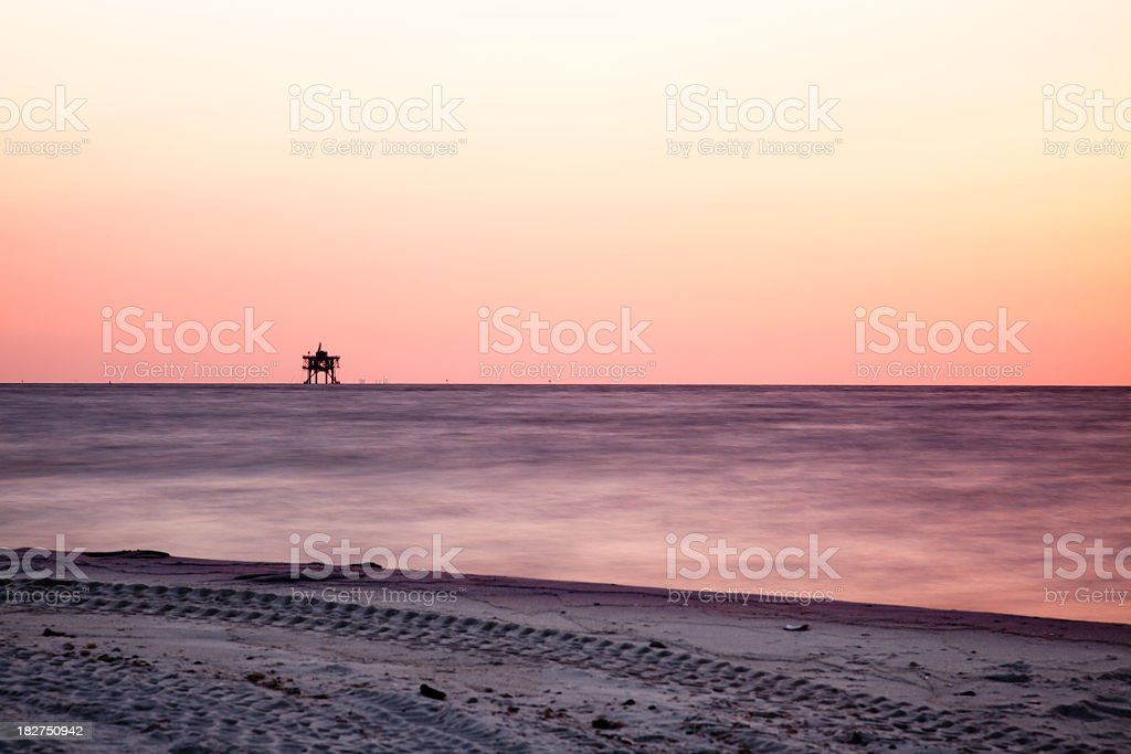 Off shore oil platform at Sunset royalty-free stock photo