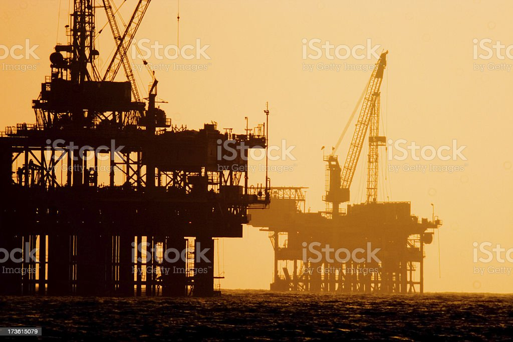 Off shore  oil platforms at Sunset stock photo