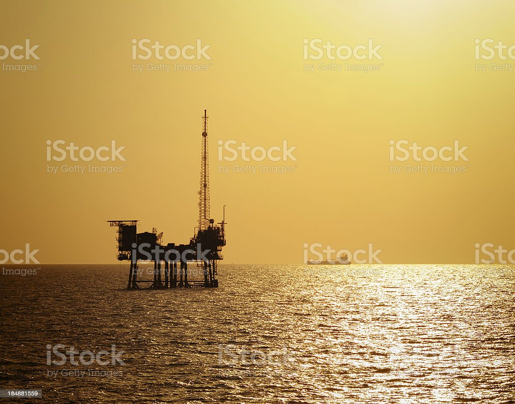 Off shore oil rig at sunset royalty-free stock photo