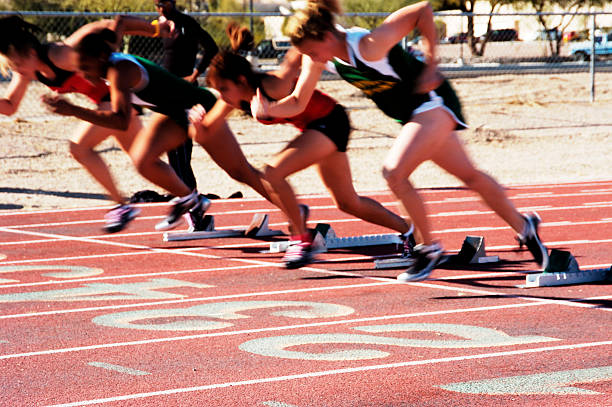 Off the Blocks  women's track stock pictures, royalty-free photos & images