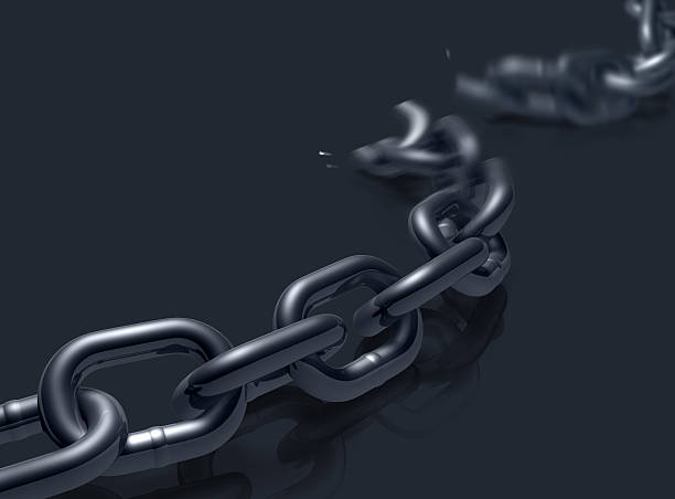 Off the Chain Heavy duty chain on a reflective floor breaking. detach stock pictures, royalty-free photos & images