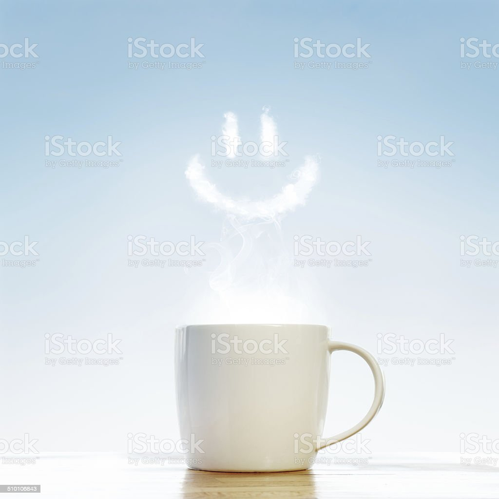 Сoffee cup with smile symbol stock photo