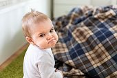 istock Offended angry upset kid sitting on the floor 1215769860