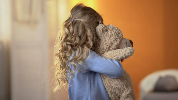 Offended girl hiding from camera, impact of parental quarrels on child, problem Offended girl hiding from camera, impact of parental quarrels on child, problem teddy bear stock pictures, royalty-free photos & images
