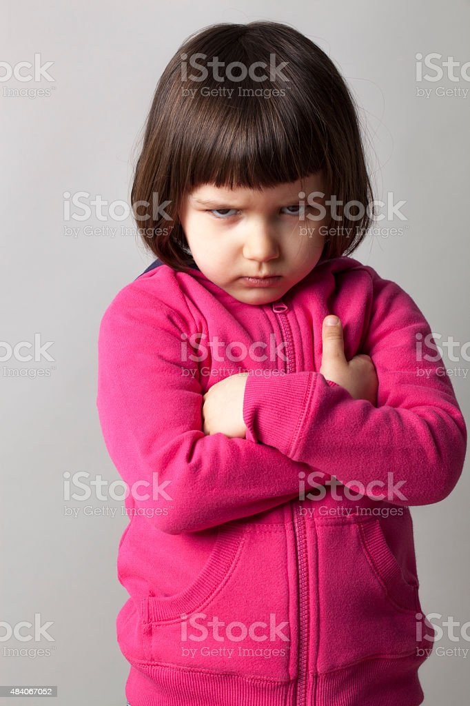 offended infant giving a dirty look to the camera stock photo