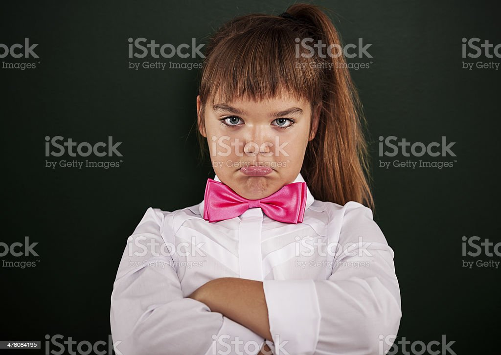 Offended little girl with pink bow tie royalty-free stock photo