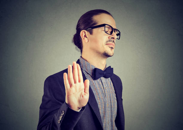 Offended man giving stopping gesture stock photo