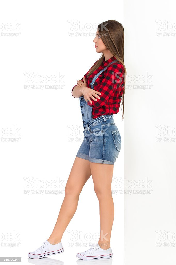 Offended Woman Leaning Against The Wall royalty-free stock photo