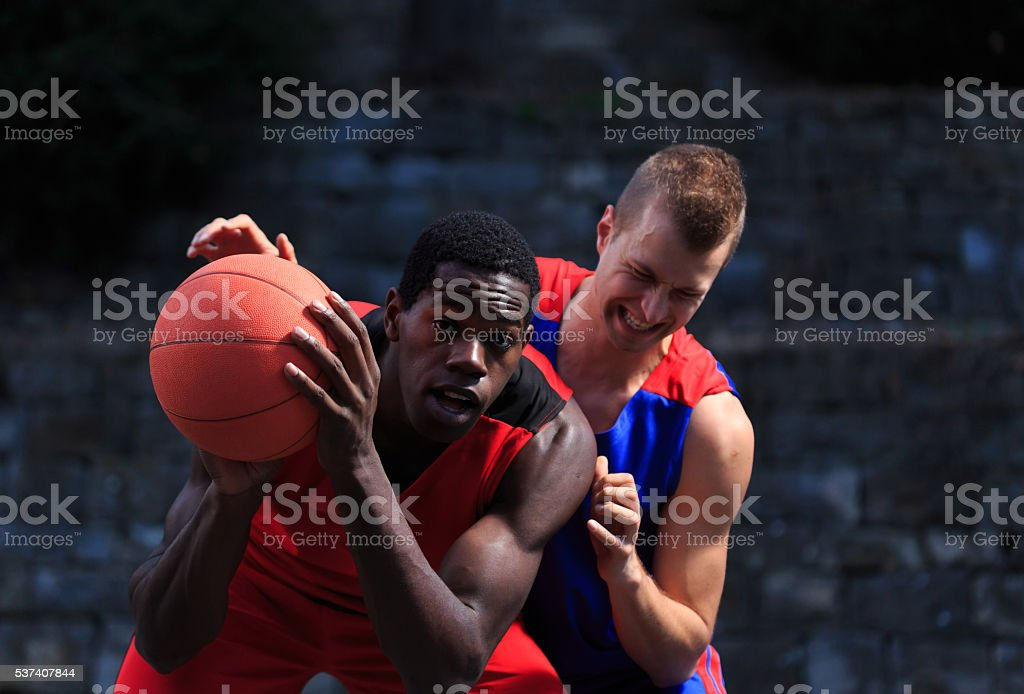 Offensive basketball game stock photo