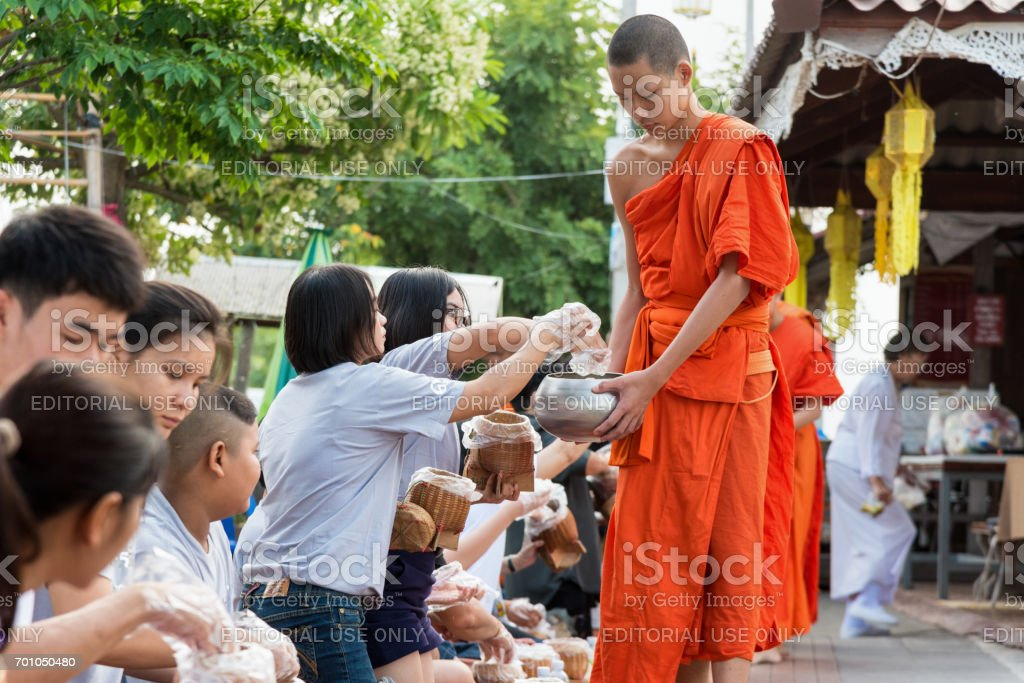 Offer food to monk stock photo