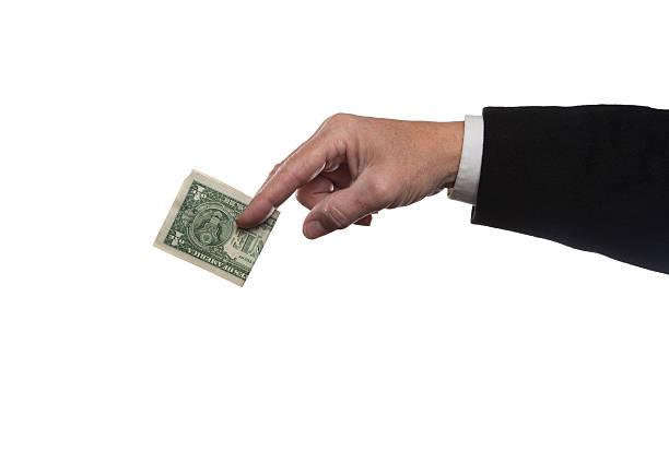 Offering a dollar bill stock photo
