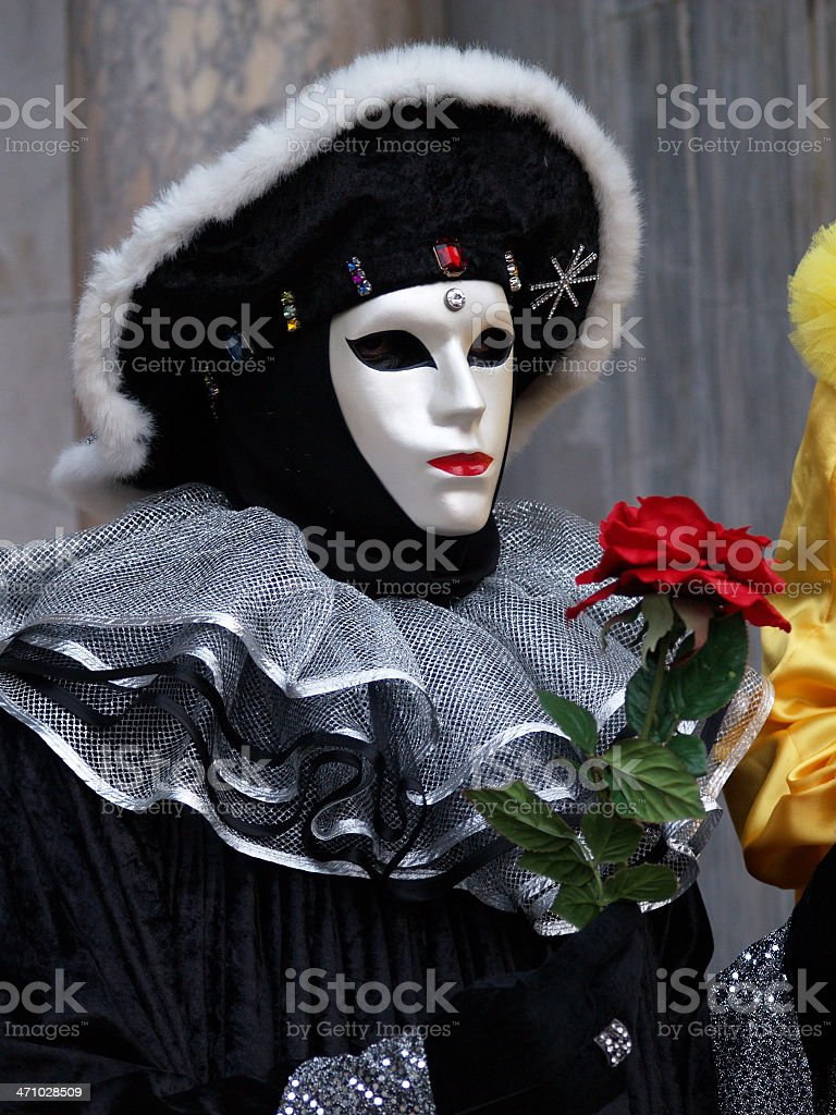 Offering a Rose; Carnival in Venice. royalty-free stock photo