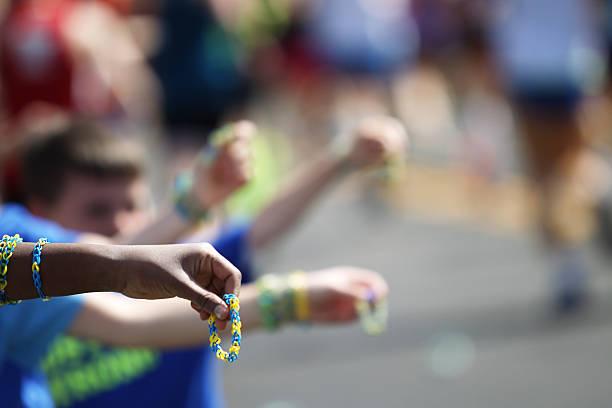 offering bracelets - boston marathon stock photos and pictures