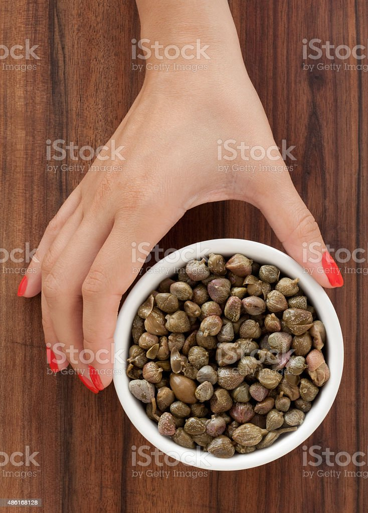 Offering capers stock photo
