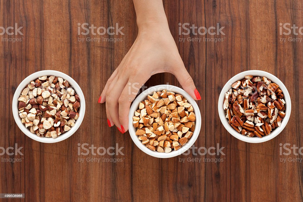 Offering chopped nuts stock photo