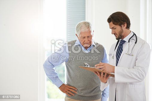 istock Offering his expert advice to his patient 613751080