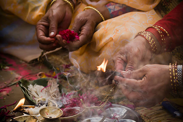 Offering in nepali hindu ceremony ( puja ) stock photo