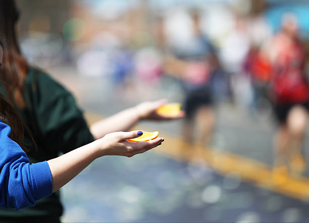 offering orange - boston marathon stock photos and pictures